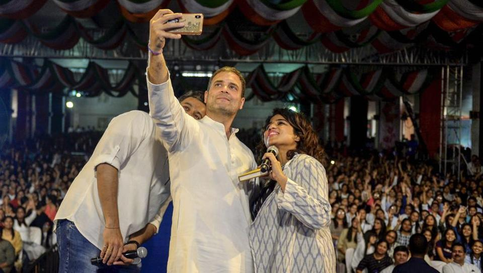 """Rahul Gandhi, president, Indian National Congress pose for a selfie during an interactive session with students in Pune on Friday.  Congress chief, during his interaction with students talked about his growth as a political leader and said """"my courage comes from experience"""". He also spoke to the students on various issues including demonetisation and job loss. With elections just a week away, he said in an assuring tone: """"I don't make empty promises."""" (PRESS TRUST OF INDIA)"""
