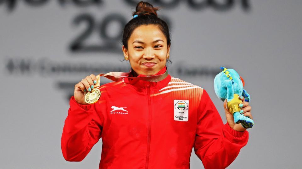Gold medalist, Chanu Saikhom Mirabai of India celebrates on the podium after the Weightlifting Women's 48kg Final on day one of the Gold Coast 2018 Commonwealth Games at Carrara Sports and Leisure Centre on April 5, 2018 on the Gold Coast, Australia.