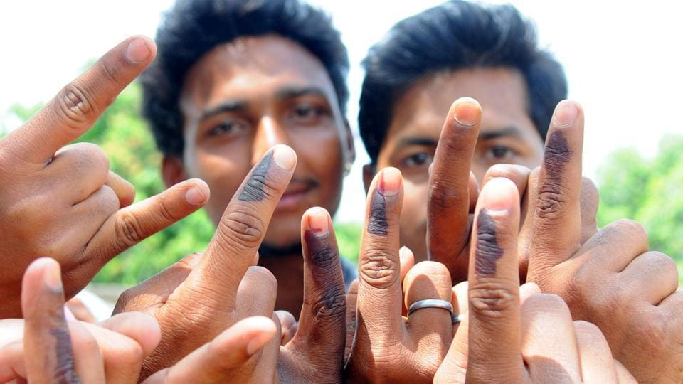Ranchi, Jharkhand, INDIA – April 17: (FILE PHOTO) Rural first time voters happily showing their voting mark after casting their votes for 2nd phase election of Lok Sabha poll for Ranchi constituency at a polling booth at Rampur in Ranchi on Thursday April 17, 2014-(Photo-Parwaz Khan-Hindustan Times) PHOTO FOR REPRESENTATIONAL PURPOSE