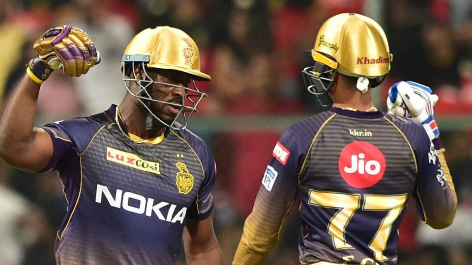 Kolkata Knight Riders (KKR) batsman Andre Russell celebrates with team mate Shubman Gill after hitting a six.