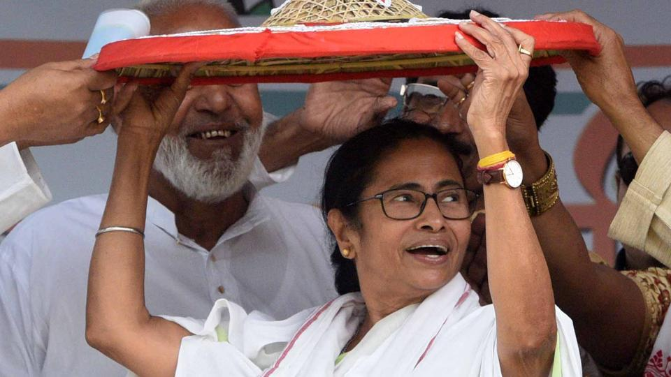 West Bengal Chief Minister Mamata Banerjee being presented with a 'Jaapi' (traditional hat of Assam) by the party supporters during the public meeting at Dhubri on Friday.