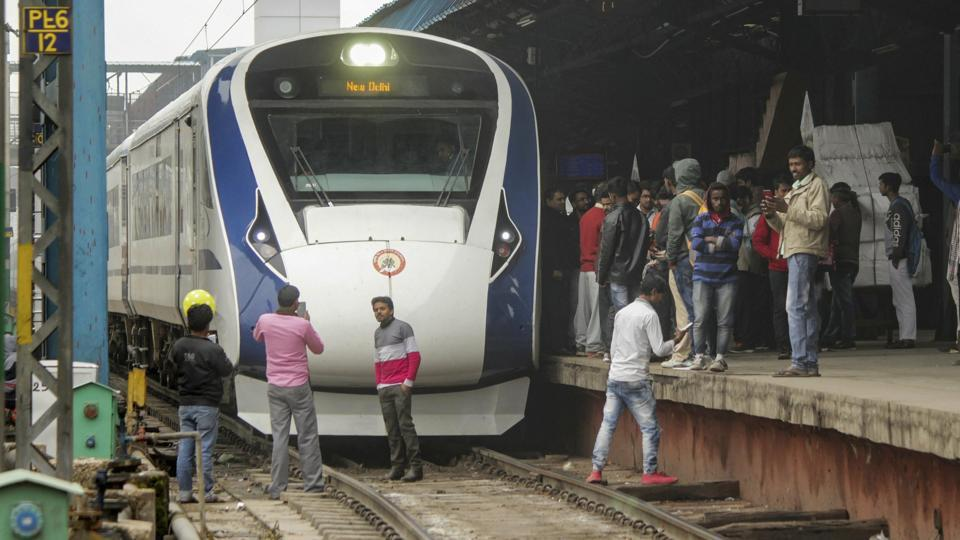 Vande Bharat Express, India's first semi-high speed train, arrives back from Varanasi after its inaugural run at New Delhi Railway Station, Saturday, Feb. 16, 2019.