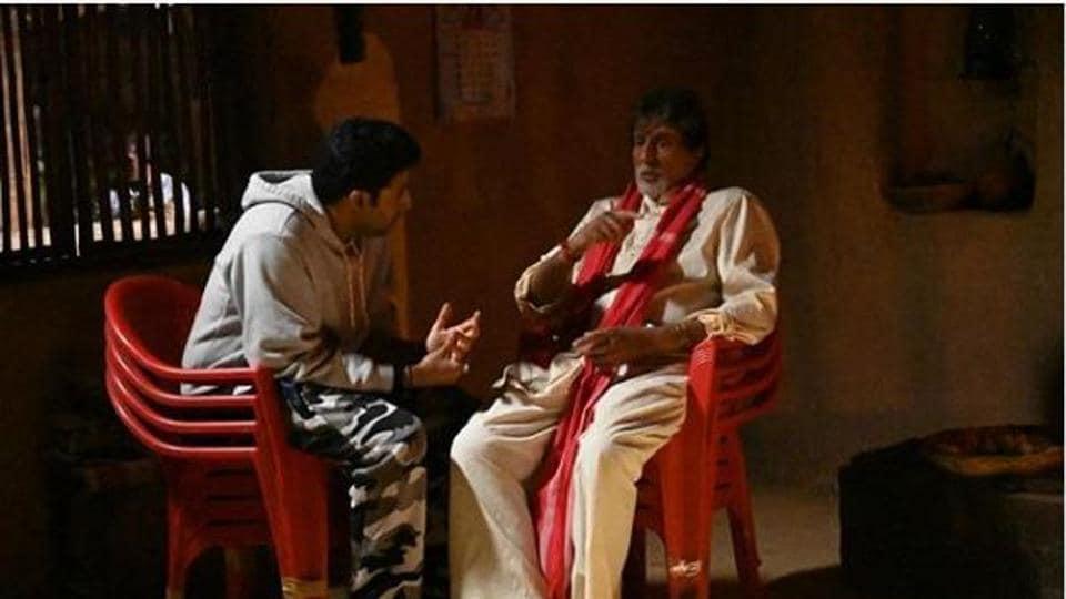 Abhishek visits dad Amitabh Bachchan on the sets of his upcoming film.