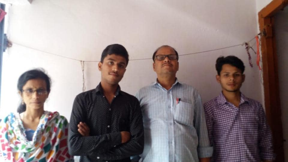 Ronit Raj, second topper with his family