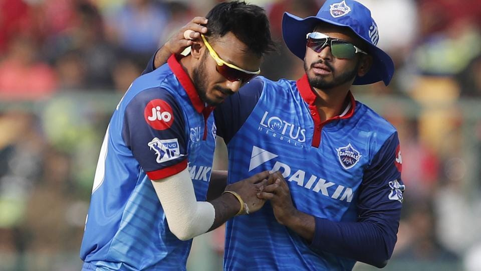 Delhi Capitals' Axar Patel, left, celebrates with captain Shreyas Iyer the dismissal of Royal Challengers Bangalore's Marcus Stoinis.