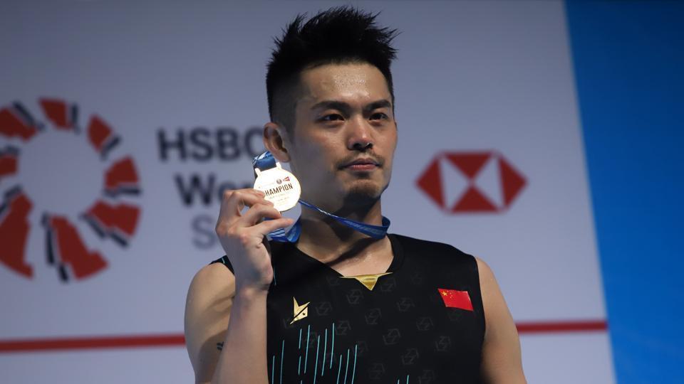Lin Dan of China poses with his medal after winning the men's singles final match against Chen Long of China at the Malaysia Open badminton tournament in Kuala Lumpur on April 7, 2019. SADIQ ASYRAF / AFP (Photo by SADIQ ASYRAF / AFP)