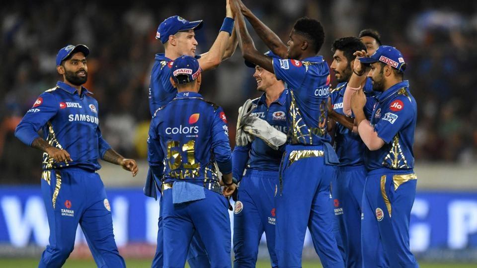 Alzarri Joseph celebrates a wicket with his teammates.