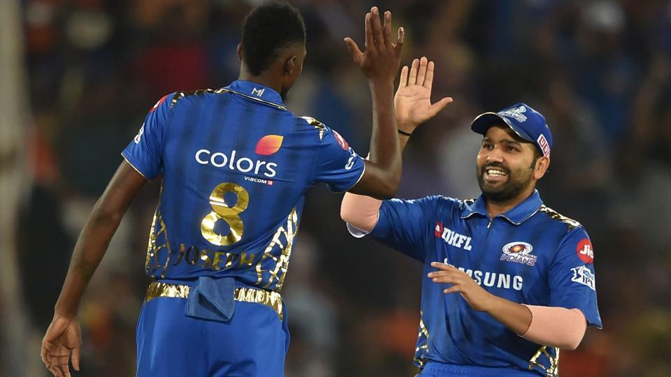 Mumbai Indians (MI) captain Rohit Sharma greets bowler Alzari Joseph.