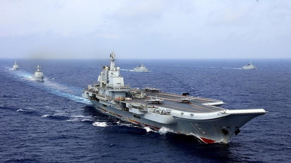 China's aircraft carrier Liaoning takes part in a military drill of Chinese People's Liberation Army (PLA) Navy in the western Pacific Ocean, in April 2018.