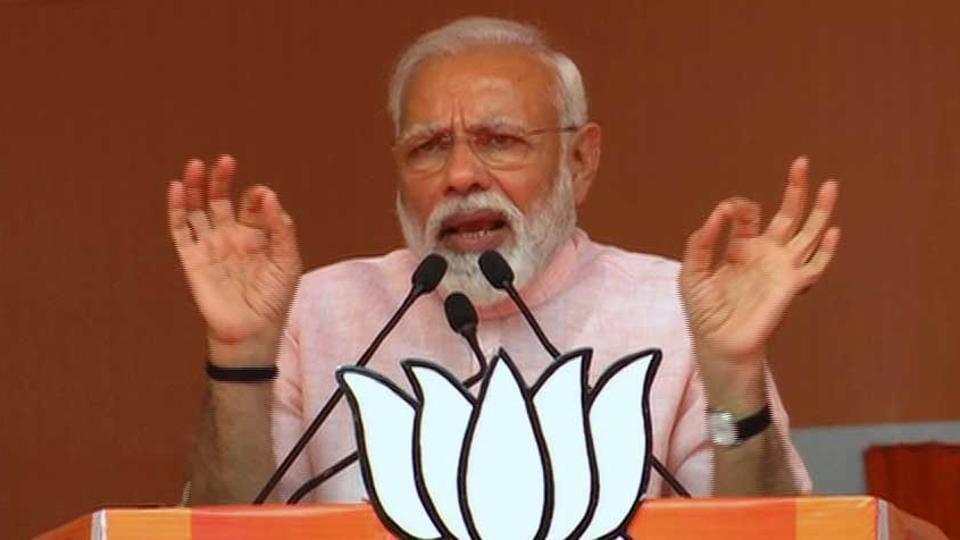 PM Narendra Modi addresses a public meeting in Amroha on Friday.