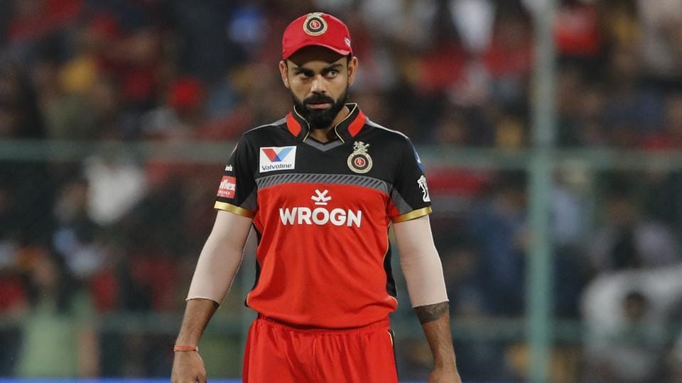 Royal Challengers Bangalore captain Virat Kohli walks into the field at the start of the VIVO IPL T20 cricket match between Royal Challengers Bangalore and Mumbai Indians in Bangalore