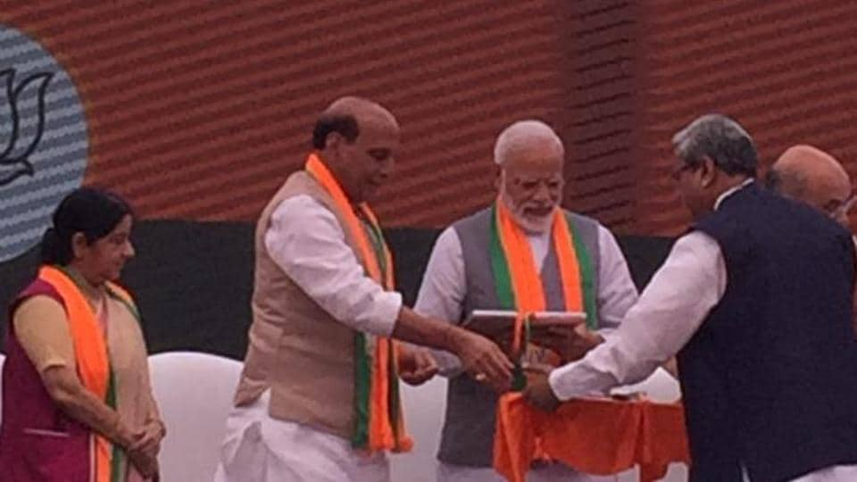 Prime Minister Modi releasing the BJP Sankalp Patra, the LokSabha poll manifesto.