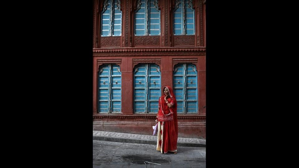 A woman stands outside the Rampuriya haveli. Such decay is not confined to Bikaner, with historic residences falling apart in other major Indian cities where the old quarters have been felled by rapid urban development. In India's only UNESCO heritage listed city, Ahmedabad, efforts have been made to preserve the clusters of settlements identified as having huge historic value. (Chandan Khanna / AFP)