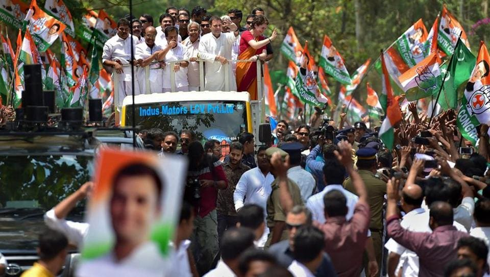 Congress President Rahul Gandhi along with party General Secretary and Uttar Pradesh-east in-charge Priyanka Gandhi Vadra and other leaders wave at party supporters during a roadshow ahead of his nomination filing, in Wayanad, April 4