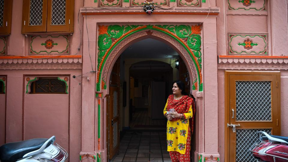 "Some families have taken matters into their own hands, reconstructing the dilapidated manors and reinventing them as hotels and guesthouses. ""We decided to open this so that others too can experience living in a haveli, and it becomes more manageable for us to maintain this huge property,"" said Manisha Maloo, whose family manages a popular homestay in the old city. (Chandan Khanna / AFP)"