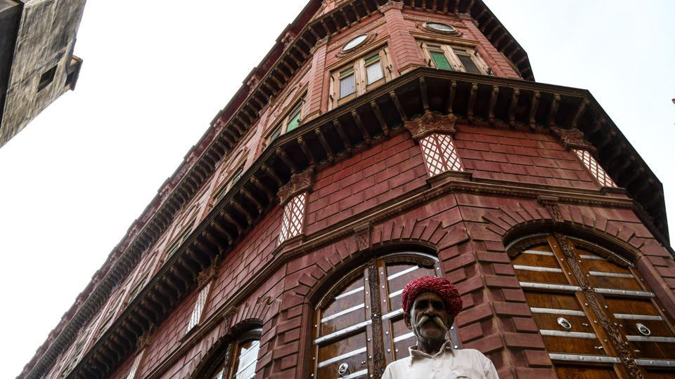 A man stands outside a haveli in the old quarters of Bikaner, in the state of Rajasthan. First built in the 15th century by Bikaner's bygone aristocracy, many boasted multiple levels, large balconies, and grand rooms built around a central courtyard, enclosed to escape the summer heat. But after decades of neglect, a large number lie in ruins. (Chandan Khanna / AFP)