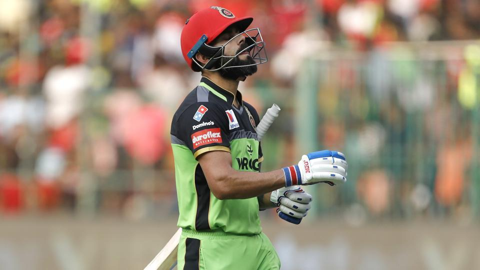 Royal Challengers Bangalore captain Virat Kohli reacts as he leaves the field after being dismissed