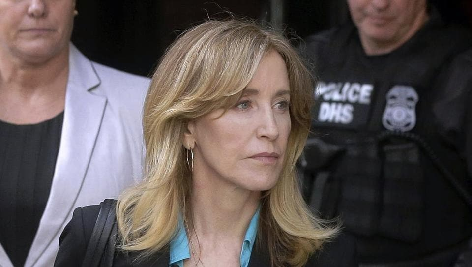 Felicity Huffman arrives at federal court in Boston to face charges in a nationwide college admissions bribery scandal