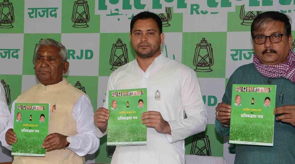 RJD leader Tejashwi Yadav releases his party's election manifesto in Patna on Monday.