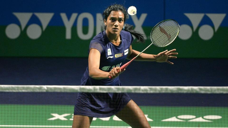 PV Sindhu plays a shot against China's badminton player He Bingjiao.