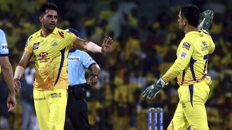 Deepak Chahar and MS Dhoni of Chennai Super Kings celebrate after taking the wicket of Robin Uthappa.