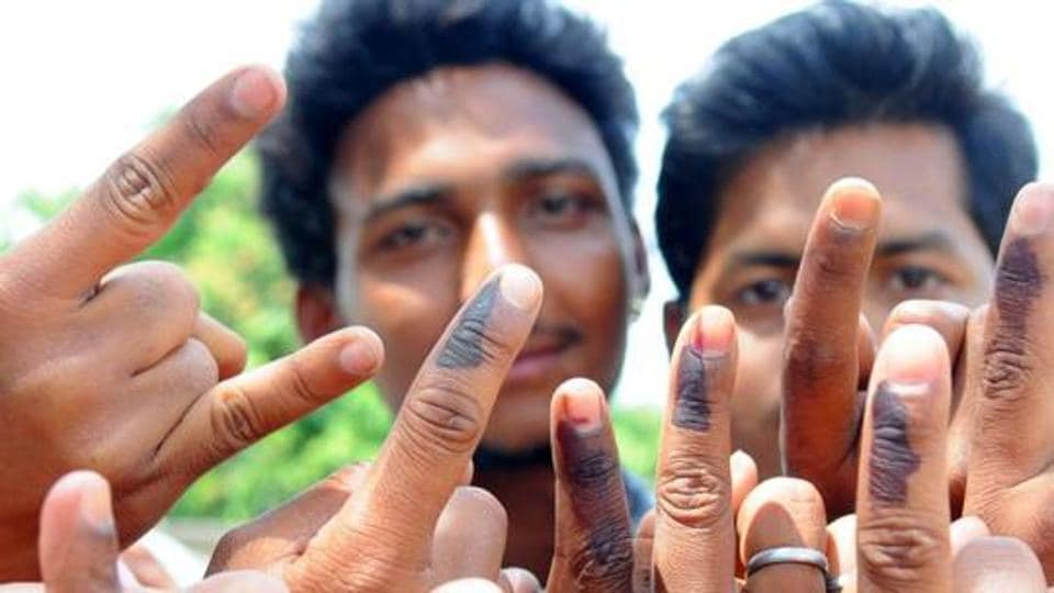 Ranchi, Jharkhand, INDIA – April 17: (FILE PHOTO) Rural first time voters happily showing their voting mark after casting their votes for 2nd phase election of Lok Sabha poll for Ranchi constituency at a polling booth at Rampur in Ranchi on Thursday April 17, 2014-PHOTO FOR REPRESENTATIONAL PURPOSE
