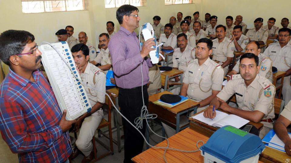 Ranchi, India - March 26, 2019:Police officials watching a film on the use of electronic voting machine(EVM) and VV-PAT during a training programme for the Lok Sabha poll organised by the election commission at JVM , Shyamali school campus in Ranchi, India, on Tuesday, March 26, 2019. (Photo by Diwakar Prasad/ Hindustan Times)PHOTO FOR REPRESENTATIONAL PURPOSE