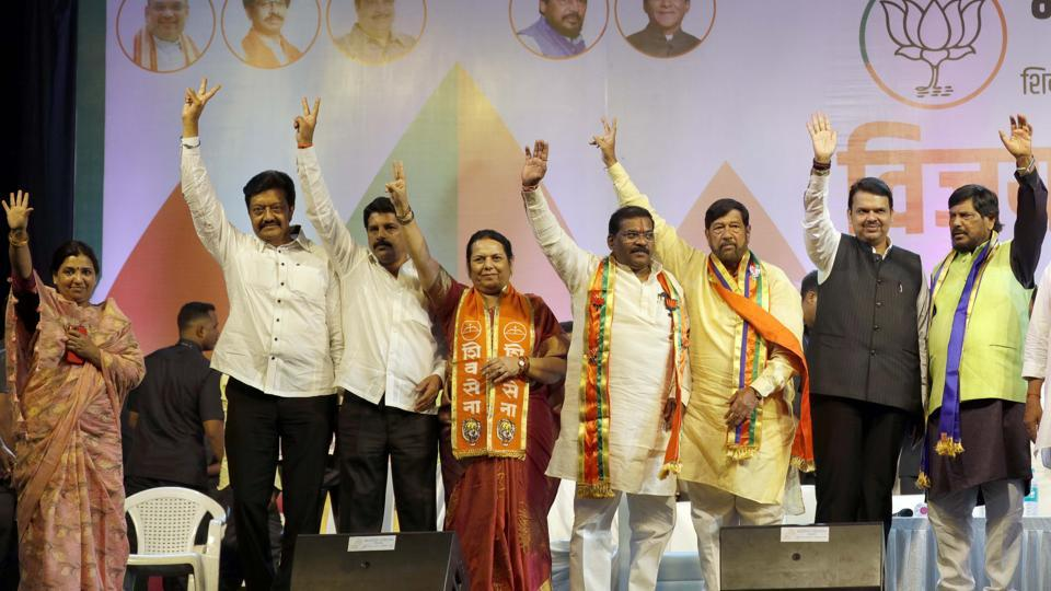 (From left) Madhuri Misal; BJP MLA from Parvati, Anil Shirole; MP from Pune, Bhimrao Tapkir; BJP MLA from Khadakwasla, Neelam Gorhe; Shiv Sena leader, Dilip Kamble; BJP MLA from Pune, Girish Bapat; Pune guardian minister, Devendra Fadanavis; chief minister and Ramdas Athawale, president, Republican Party of India during a Bharatiya Janata Party rally at Mahatma Phule school, Nana peth on Tuesday. (RAHUL RAUT/HT PHOTO)