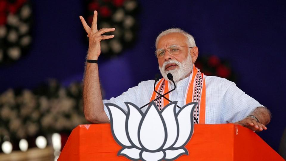 Prime Minister Narendra Modi addresses an election rally in Junagadh, Gujarat on Wednesday.
