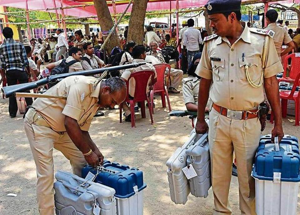Security officials carry EVMs in Jamui on Wednesday.