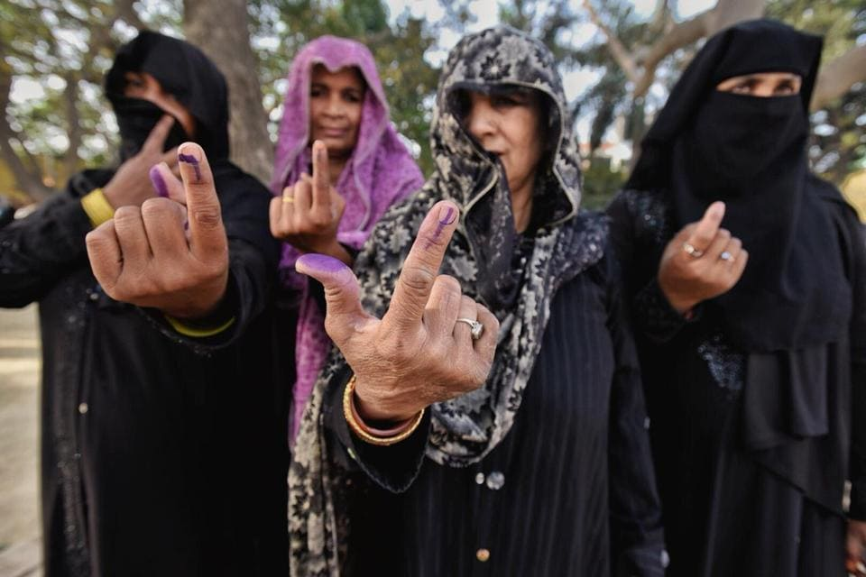 Women shows their ink-marked fingers after casting votes at a polling station in Sawaal near Meerut early in the morning in Uttar Pradesh. Ninety-one Lok Sabha constituencies spread across 18 states and two Union Territories, including all in Andhra Pradesh and Telangana, are going to polls on Thursday in the first-phase. (Raj K Raj / HTPhoto)