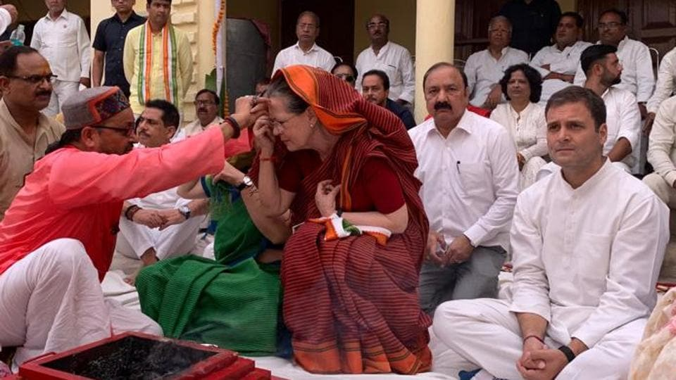 UPA chairperson Sonia Gandhi performing puja before filing her nomination papers in Rae Bareli on Thursday. Congress president Rahul Gandhi was present during the havan ceremony.