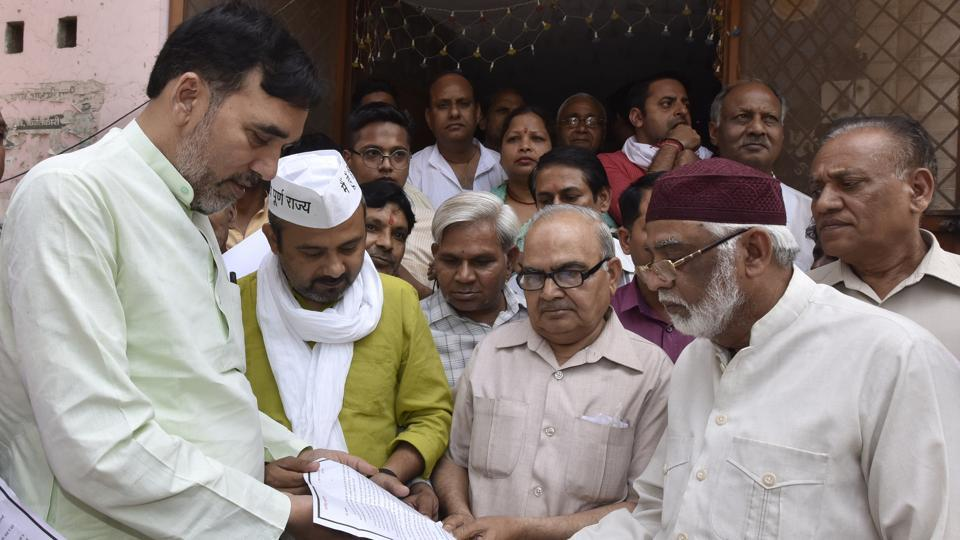 (From left) AAP leaders Gopal Rai and Dilip Pandey visited voters in northeast Delhi's Babarpur on Wednesday, April 10, 2019.