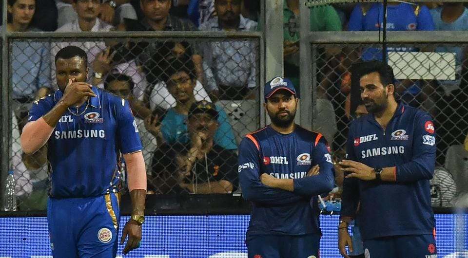 Mumbai Indians cricketer and stand-in captain Kieron Pollard (L) looks on as Mumbai Indians captain Rohit Sharma (C) talks with team technical director cricket operations, Zaheer Khan (R) during the 2019 Indian Premier League (IPL) Twenty20 cricket match between Mumbai Indians and Kings XI Punjab at the Wankhede cricket stadium in Mumbai on April 10, 2019