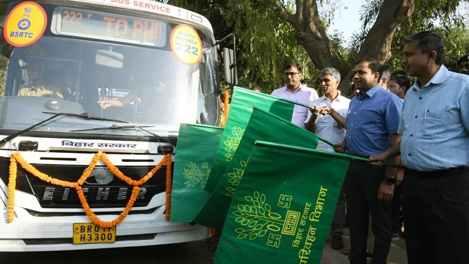 Electoral officer with DM Kumar Ravi and Sanjay Kumar are giving flag of buses for Voters Awareness at the campus of State Election office in Patna.Bihar India on Wednesday April 10,2019