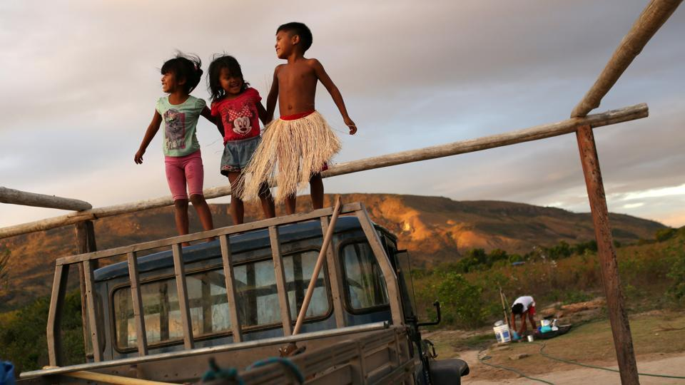 Indigenous Macuxi children play at the community of Maturuca on the Raposa Serra do Sol reservation, Roraima state, Brazil. A decade after the Macuxi people won a bloody legal battle to expel rice planters from their reservation in a remote part of Brazil, their hold over ancestral lands has come under threat again from new right-wing President Jair Bolsonaro. (Bruno Kelly / REUTERS)