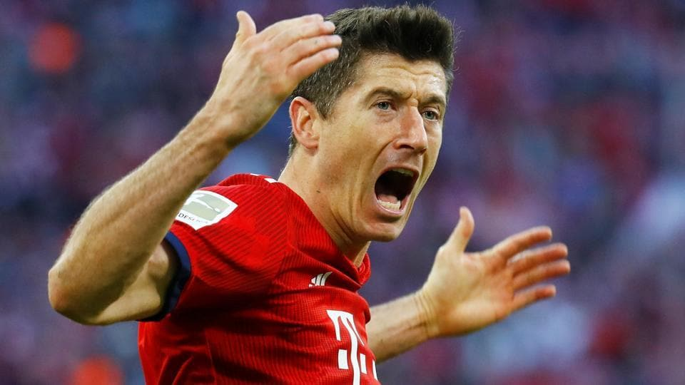 Bayern Munich's Robert Lewandowski celebrates scoring their second goal.