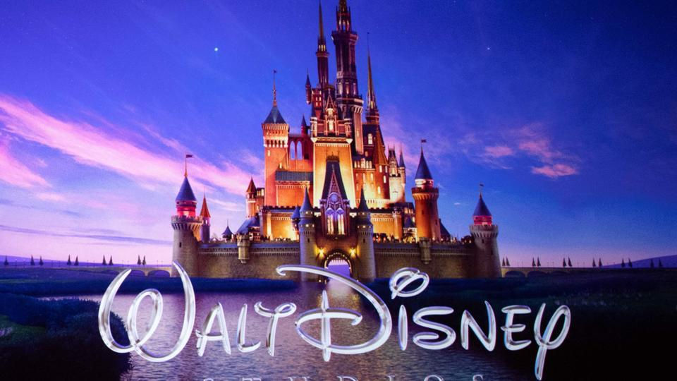 In this file photo taken on April 3, 2019 the Walt Disney Studios logo is projected onscreen during the CinemaCon.