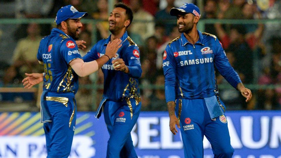 Mumbai Indians fielder Suryakumar Yadav (C) celebrates with his captain Rohit Sharma (L).