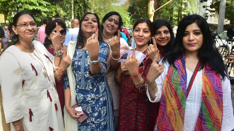 Noida: People show their finger marked with indelible ink, after casting their vote during the first phase of general elections, at a polling station in Noida, Thursday, April 11, 2019. (PTI Photo / Manvender Vashist)(PTI4_11_2019_000121B)