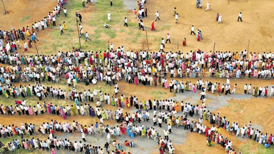 Mumbai, India - October 13, 2009: People queue to cast their votes outside a polling center during the Maharashtra state elections in Chandivali, Mumbai, on October 13, 2009. (Photo by Manoj Patil / HT Archive)