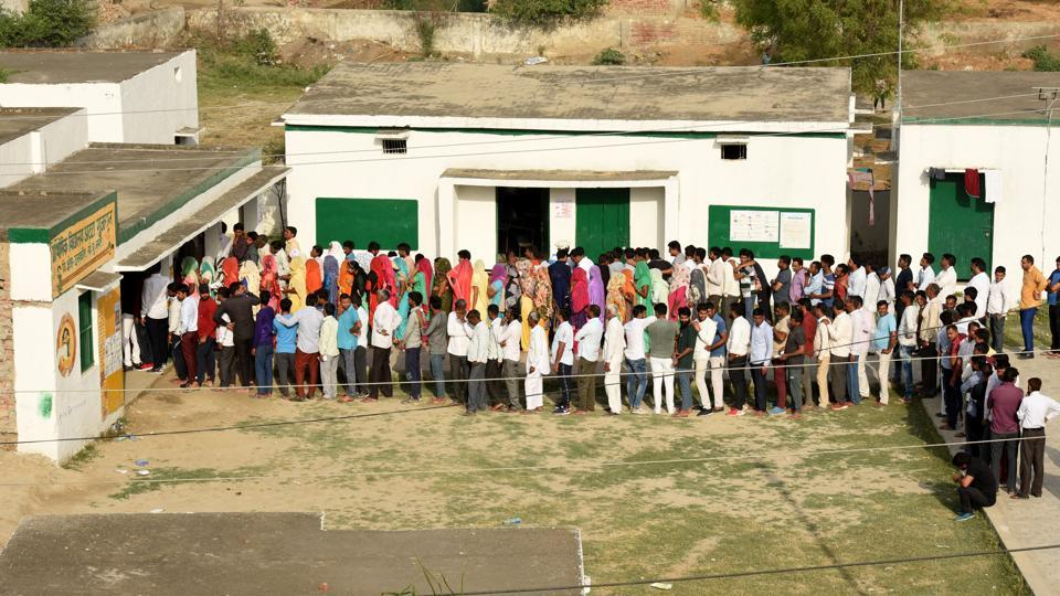 Greater Noida, India - April 11, 2019: People stand in queues to cast their votes during the first phase of the Lok Sabha elections, at Atta Gujjran in Greater Noida, India, on Thursday, April 11, 2019. (Photo by Virendra Singh Gosain/ Hindustan Times) **To go with Preety's story.
