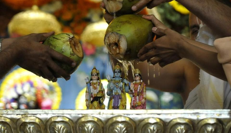 On the occasion of Ram Navami, devotees pay tribute to the idol of Lord Rama, in Noida, India.