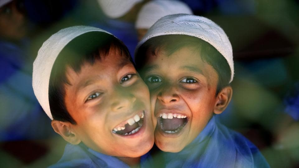 Rohingya refugee boys who study in an Islamic school smile as they react to the camera at a refugee camp in Cox's Bazar, Bangladesh. (Mohammad Ponir Hossain / REUTERS)
