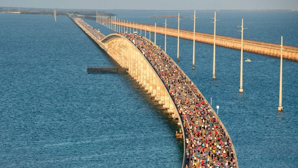 A portion of the field of 1,500 participants begins the trek to the highest point over the Florida Keys Overseas Highway's longest span during the Seven Mile Bridge Run near Marathon, Florida. (Andy Newman / Florida Keys News Bureau / AFP)