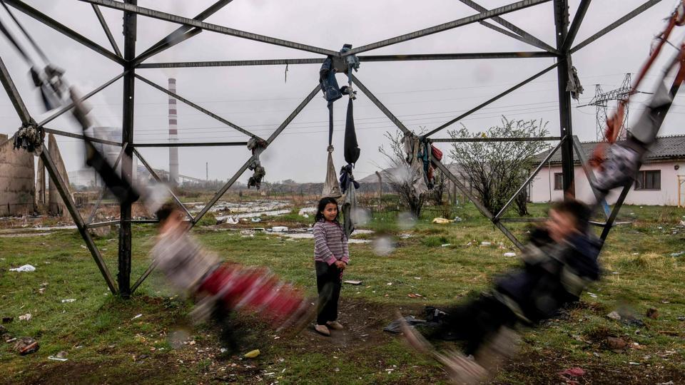 Roma children swing on tied clothes near their shelter at a Roma Camp in the village of Plemetina, near Pristina in Kosovo, during the International Roma Day marked around Europe to celebrate Romani culture and raise awareness of the situation of Roma. (Armend Nimani / AFP)