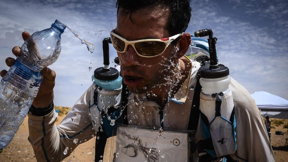 A competitor splashes water on his face during the fourth stage of the 34th edition of the Marathon des Sables between Jebel El Mraier and Rich Mbirika in the southern Moroccan Sahara desert,. The 34th edition of the marathon is a live stage 250 kilometres race through a formidable landscape in one of the world's most inhospitable climates. (Jean-Philippe Ksiazek / AFP)