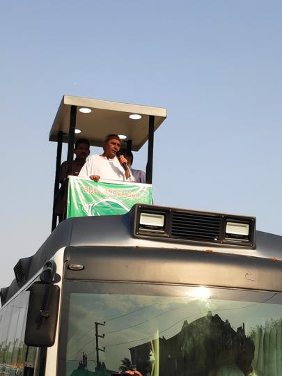 Odisha Chief Minister Naveen Patnaik addressing a crowd  from his campaign bus at Hinjili during a roadshow on Saturday.