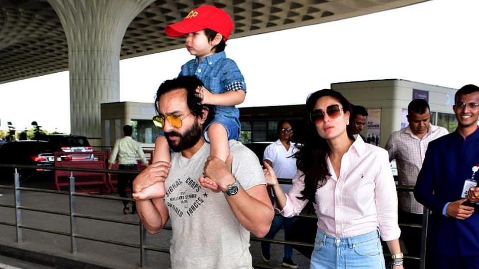 Taimur Ali Khan sits atop dad Saif's shoulders at airport.