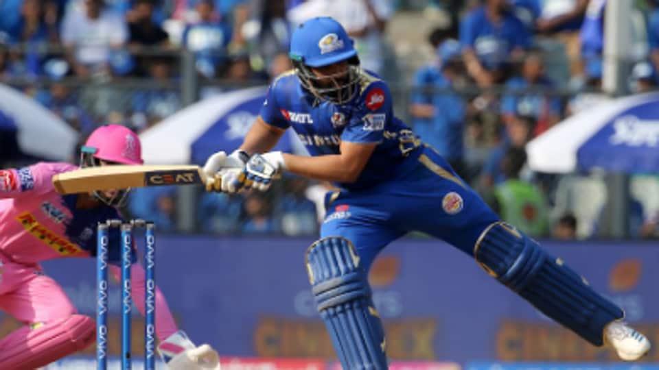 Rohit Sharma uses his leg to stop a ball.